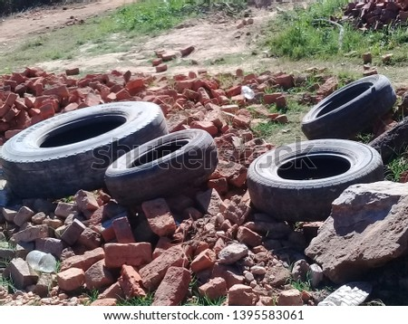 A junkyard with rimless tires. The tires are rimless. #1395583061