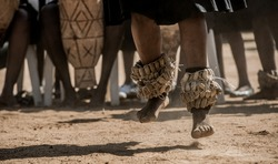 A Kalanga Traditional Group Dancing and Celebrating To The Beat of Drums With Snare Around Their Ankles During A Traditional Wedding.