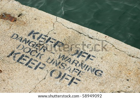 A Keep Off Warning Sign on an Unsafe Dock