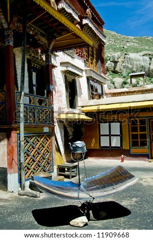A kettle is boiled using a parabolic reflector at Sera Monastery in Tibet