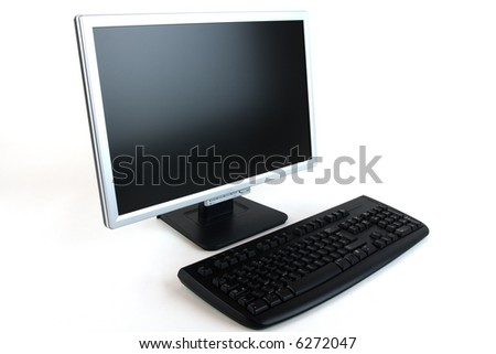 A keyboard and computer lcd monitor against a white background