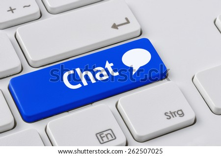 A keyboard with a blue button - Chat