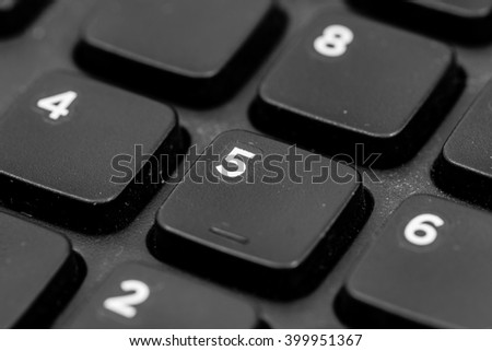 A keyboard with a button 5
