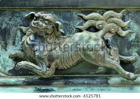 A Ki-lin (Kirin) image on oxidized bronze.