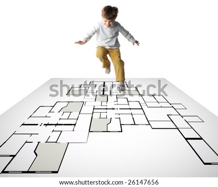 a kid playing and jumping on a digital blueprint