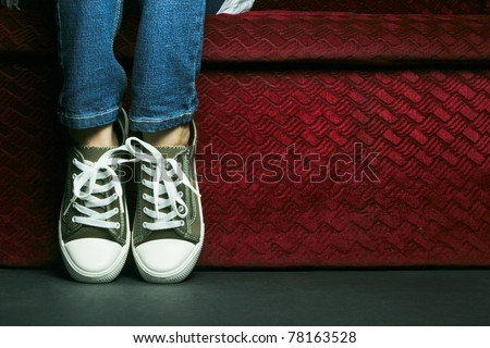 A kid posing her feet. - stock photo