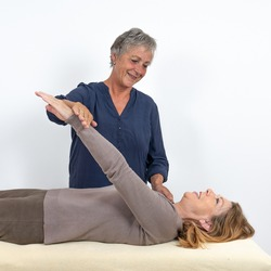 A kinesiologist tests a muscle in a client to see if this muscle is functioning properly.