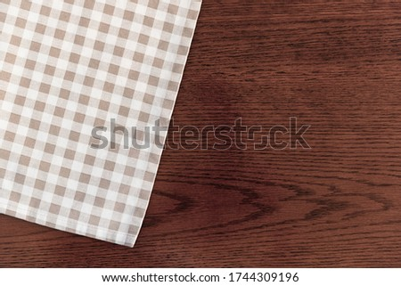 A Kitchen towel or napkin over the wooden table. Close up. Stockfoto ©