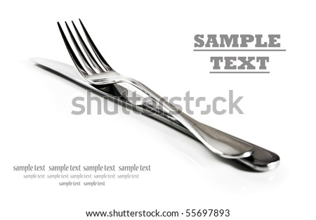a Knife and fork stacked up on a pure white background with space for text