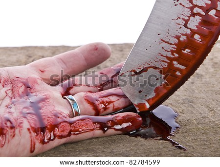 A knife smeared with blood and hand