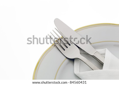 a knife with a fork and plate. place setting for a dinner at the restaurant.