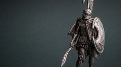 A knight armed in armor armed with a sword and shield. The tin soldier.