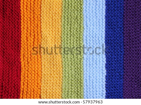 a knitted background in rainbow colors