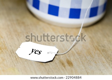 a label from a tea bag with a note on it - stock photo