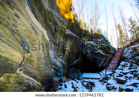 a ladder in the stone mountains among the trees #1159461781