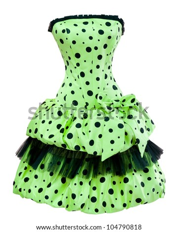 a ladies green polka dot cocktail dress with a balloon skirt, isolated