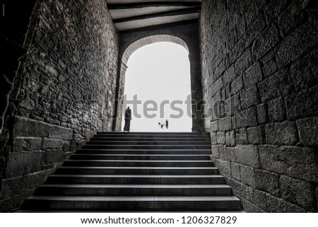 A lady goes through the tunnel of the Cathedral of Santiago de Compostela on July 24, 2013, close to the schedule of the railway accident on the Angrois curve. #1206327829
