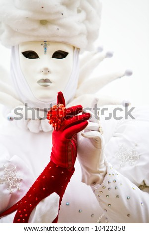 A lady in a white costume and one red glove at the Venice Carnival