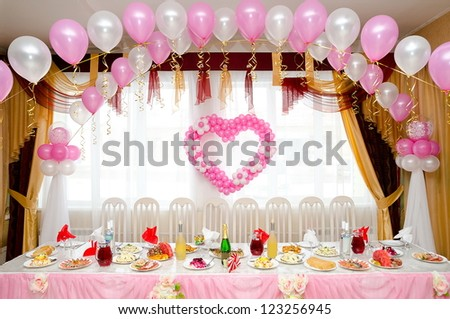 a laid restaurant table, decorated for a wedding party