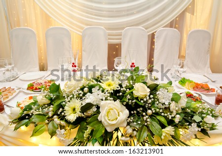 a laid wedding banquet table at a restaurant