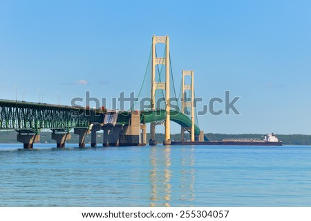 A lake freighter crossing under the Mackinac Bridge, heading from Lake Huron to Lake Michigan