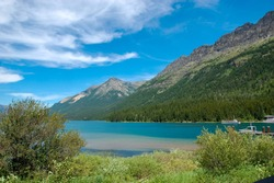 a lake in front of the mountains in canada
