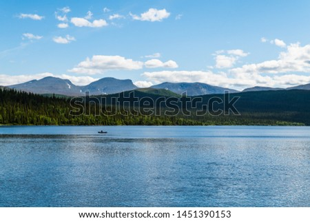 A lake in northern Sweden located in Fatmomakke along the wilderness road #1451390153