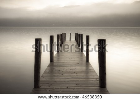 A landing jetty at Derwent water on a misty Autumn morning - stock photo