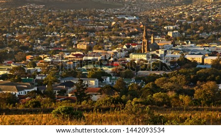 A landscape image of the town of Makhanda (Grahamstown), South Africa during sunset.