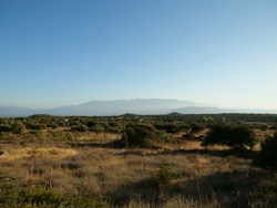 A landscape of wild fields and mountains in Crete, Greece