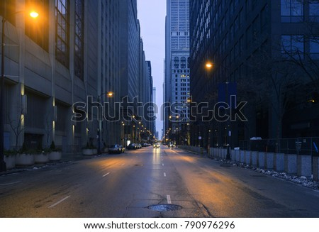 A landscape phot of downtown Chicago. The shot is taken from the middle of the street. #790976296