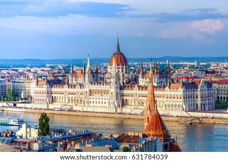 Stock Photo A landscape view of Budapest city in the evening, the Hungarian parliament building and otherr buildings along Danube river, Hungary.