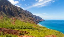 A landscape view of the Na Pali Coast at the ridge leading to Kalalau Beach on Kauai