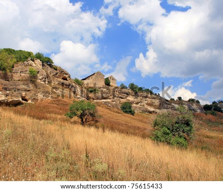 A landscape with ancient brick building, the Chufut-Kaleh Cave Town near Bakhchisarai in the Crimea