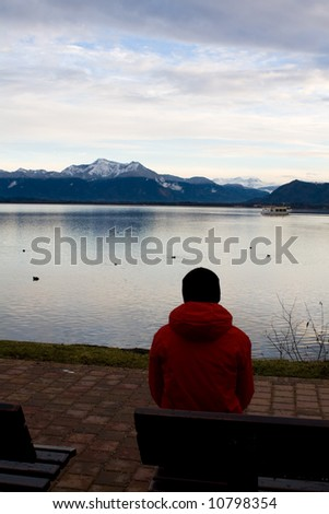 A landscape with lake and mountains in winter. Alps, Chiemsee.