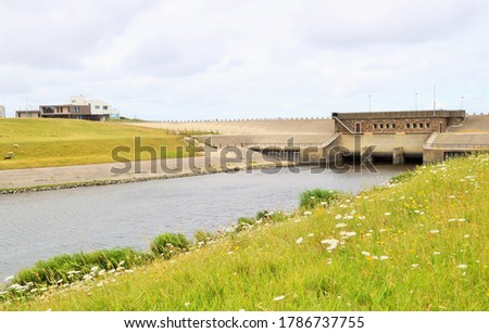 Photo of  a landscape with meadow and waterway