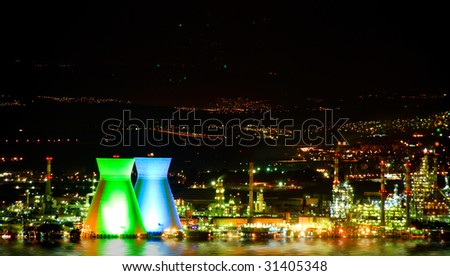 A landscape with the illuminated chemical  factory.