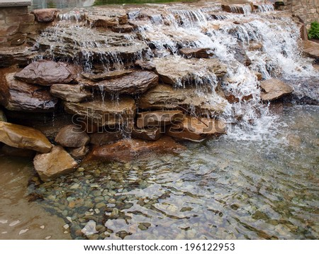 a landscaped waterfall made of stacked rocks