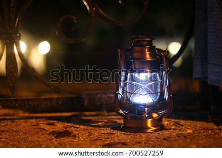 A lantern illuminates the way during a ghost tour in St. Augustine, Florida.