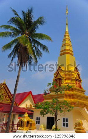 a Lao style temple in a golden stupa in the northeastern of Thailand