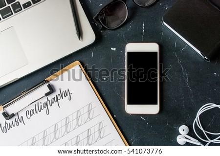 a laptop  a tablet  a earphones ...