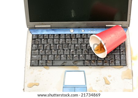 a laptop computer with spilled liquid on the keyboard isolated on white