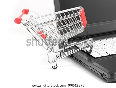 a laptop with a shopping-cart isolated on white with reflection
