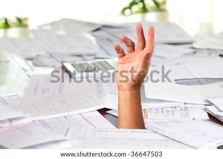 A large amount of bills spread all over the place with hand asking for help