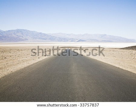 A large and straight road at Death Valley National Park