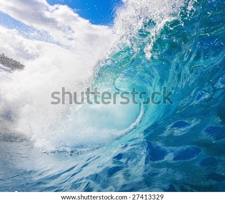A Large Blue Wave Crashes onto the Reef in Tropical Ocean, Perfect Surfing - stock photo