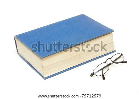 A large book alongside a pair of reading glasses for the educated mind.