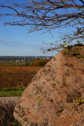 A large boulder on the side of a hill on the countryside of Fond du Lac, Wisconsin