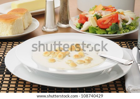 A large bowl of oyster stew with crab salad