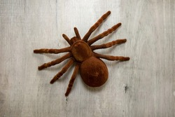 A large brown fake tarantula, Halloween theme background.